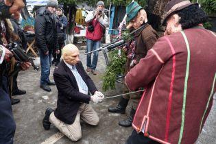 Masks of UPA partisans execute a man playing Vladimir Putin
