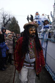 Masked characters mingle with tourists in Vashkivtsi