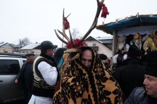 A man from Romania wears an ancient costume of a goat