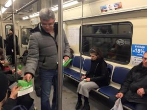 "Boris Nemtsov on the metro handing out flyers for upcoming ""Spring"" Anti-Crisis March, Feb 15, 2015 (Source: Facebook)"
