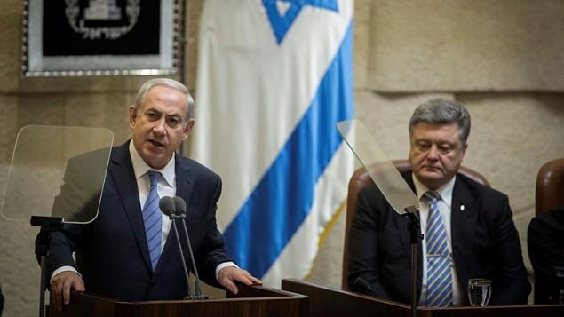 Prime Minister Benjamin Netanyahu speaks during a special plenary session held in honor of visiting Ukrainian President Petro Poroshenko (R) at the Knesset, Jerusalem, on December 23, 2015. (Flash90/Hadas Parush)