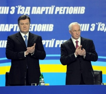 Disgraced Ukrainian president Yanukovych (left) stands next to Mykola Azarov (right) at the 13th congress of their Kremlin-allied Party of Regions
