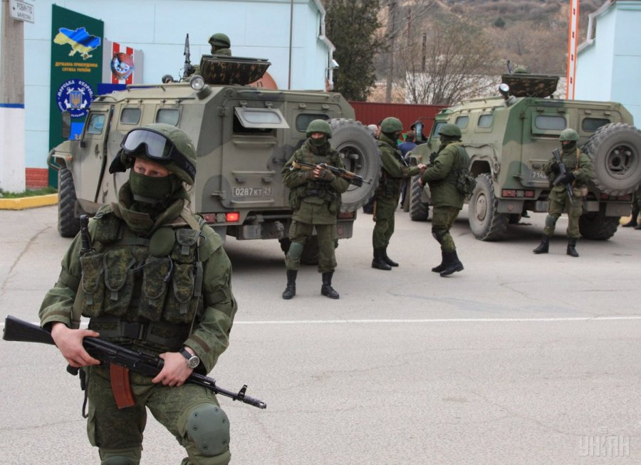 "First, Russia claimed there were the ""little green men"" in Crimea, not the Russian military, as Putin later admitted a year later. Russian special services troops besieging a Ukrainian military base in Crimea, February 2014. (Image: UNIAN)"