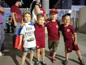 "Russian children football/soccer fans at the 2016 Euro Cup in France. The t-shirt shows Russia's latest battle tank T-14 ""Armata"" and sign translating from Russian as: ""Clusterf@ck to Everyone!"" (Image: social media)"