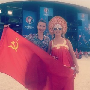 Russian female football/soccer fans posing with a national flag of the collapsed Soviet Union at the 2016 Euro Cup in France (Image: social media)