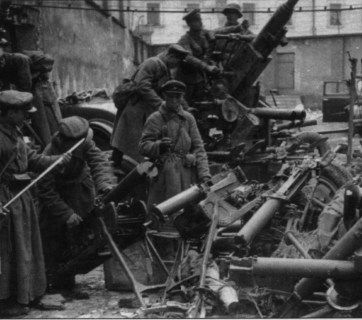 Soviet soldiers inspect some of the Polish weapons the Red Army captured during the joint German-Soviet invasion of Poland in September-October 1939, as was agreed in the Molotov-Ribbentrop Pact of 23 August 1939. The military operations ended with the two-way division and annexation of the entire territory of the Second Polish Republic by Germany and the Soviet Union.
