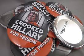 """""""Crooked Hillary For Prison"""" campaign buttons echoing Donald Trump repeated rallying cry to jail his political opponent Hillary Clinton"""