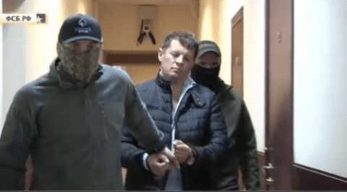 Handcuffed Sushchenko being led down the halls of a Russian remand prison. Image: snapshot from FSB video