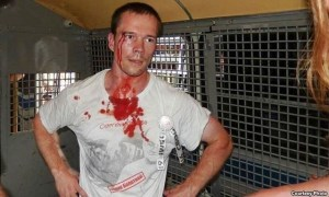 Russian opposition activist Ildar Dadin inside of the police station, after his arrest in August 2014. In December 2015 he was sentenced to three years in jail for peaceful street protests.