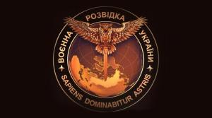 """Symbol of the Ukrainian military intelligence adopted in November 2016: an owl carrying a sword over Eurasia. Top phrase in Ukrainian says """"Military Intelligence of Ukraine."""" Bottom phrase in Latin means """"The wise man will master the stars."""""""