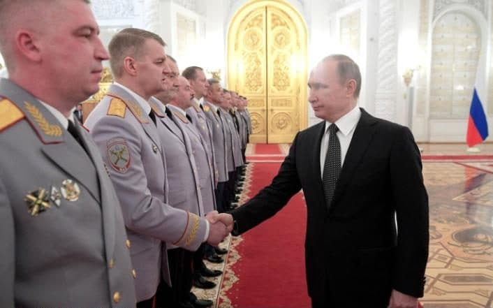Russian President Vladimir Putin greets Russian military and security services generals during a promotion ceremony at the Kremlin in Moscow (Image: Planet Pix/Rex/Shutterstock)