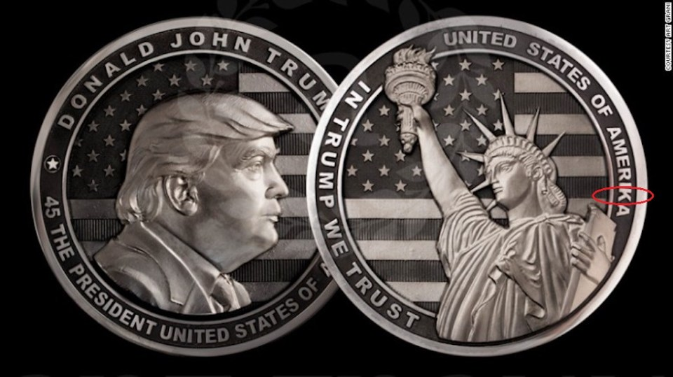 "A two-pound silver coin dedicated to Donald Trump minted in Russia for his inauguration. The back of the coins shows the Statue of Liberty against a background of the American flag with inscription reading, ""In Trump We trust."" Note the spelling errors. (Image: Art Grani)"
