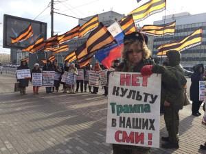 "A Russian nationalist protester holding a sign: ""No To Cult of Trump In Our Mass Media."" February 2017 (Image: @_Borodulin)"