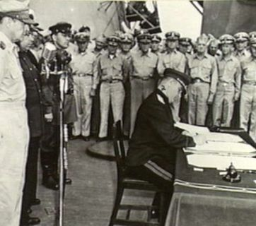 The surrender of the Japanese Empire in WWII aboard USS Missouri in Tokyo Bay, Japan on September 2, 1945. Lieutenant-General Kuzma Derevyanko representing the Soviet Union signs the instrument of surrender. In 2007, Derevyanko was awarded the title of Hero of Ukraine. Now the Russian Federation named one of the Kuril islands in honor of this famous Ukrainian. (Image: Australian War Memorial)
