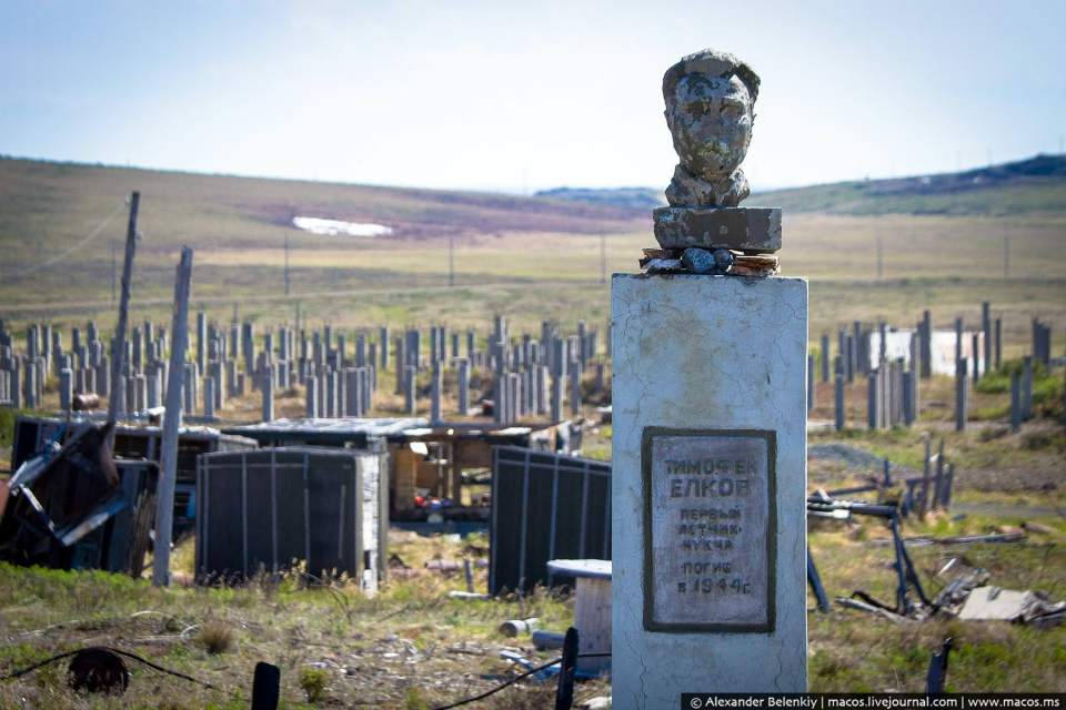 Only piles used to build in permafrost and shacks remain of a town in Russia's Chukotka Peninsula across the strait from Alaska. The now decaying monument was built to honor Timofey Yelkov, the first Chukcha pilot, who was killed in World War II (Image: Alexander Belenkiy / macos.ms)