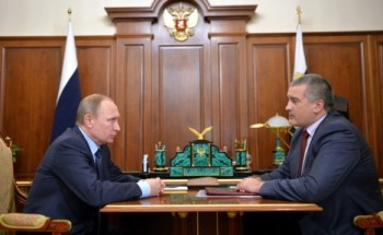 "Russian President Vladimir Putin and Crimea ""Prime Minister"" Sergei Aksionov"