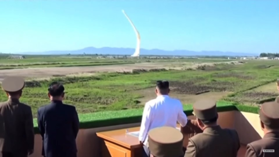 North Korean missile launch with Kin Jong Un watching