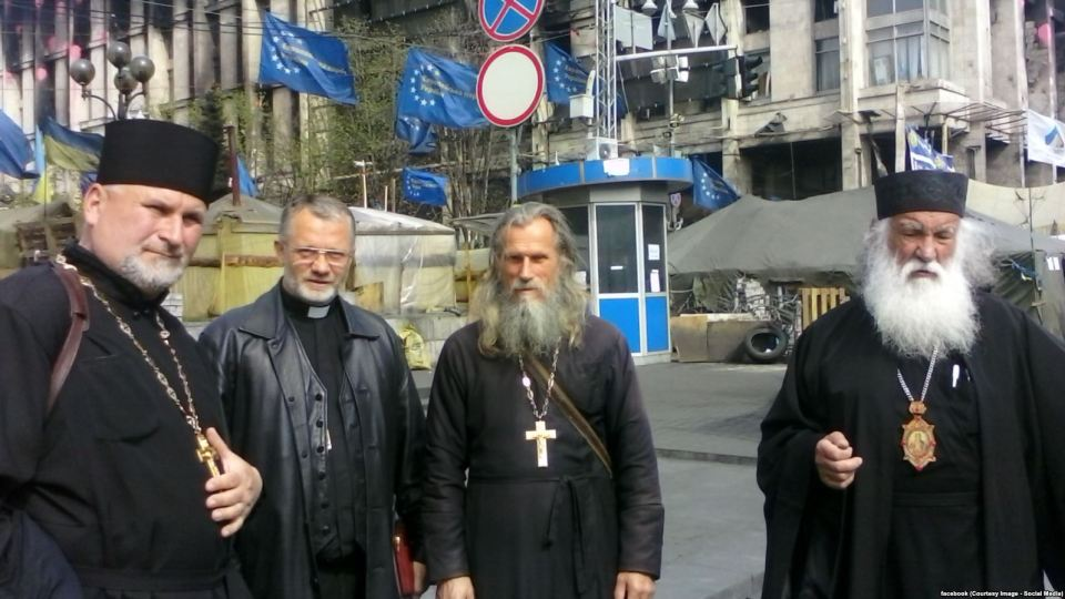 Father Valentyn in the midst of the Euromaidan camp with other priests. Photo: facebook