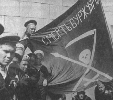 """Sailors of the Imperial Russian Navy with a sign proclaiming """"Death to the Bourgeois!"""" in 1917"""