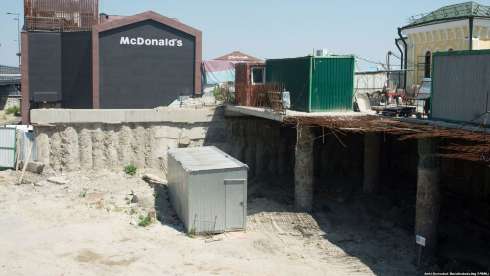The entrance to the excavation site is located right behind the Church of the Nativity of Christ and near a McDonald's