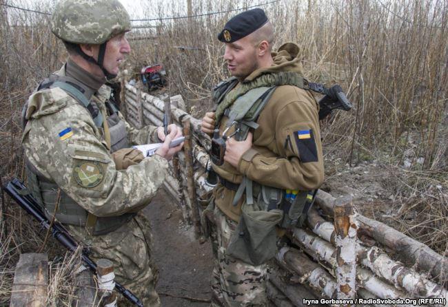 Oleksandr Kindsfater, press officer for the Mariupol sector (left) and Vadym Sukharevsky (right) near Vodyane