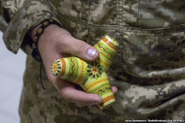 Vadym Sukharevsky holds a souvenir – a tetrapod, symbol of the defense of Mariupol
