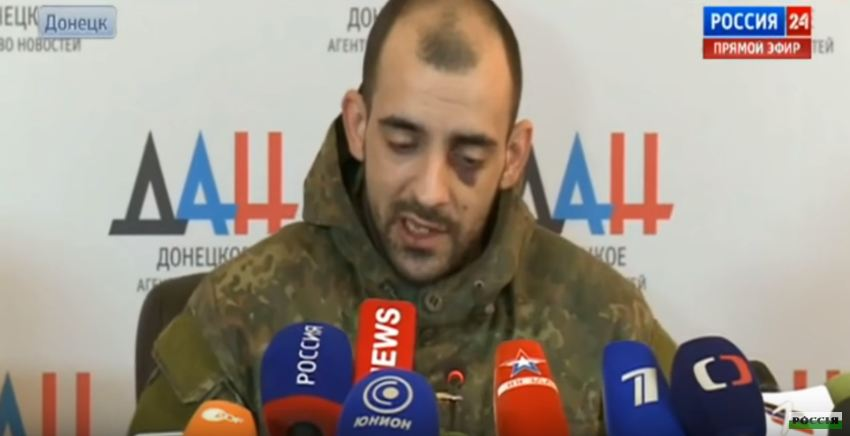 Resident of the occupied city of Makiivka, volunteer of Ukrainian Azov battalion Yevhen Chudnetsov in captivity, voicing the answers prepared by his captors at the press briefing for the Russian media outlets. Occupied Donetsk, 19 February 2015. Screenshot: Youtube