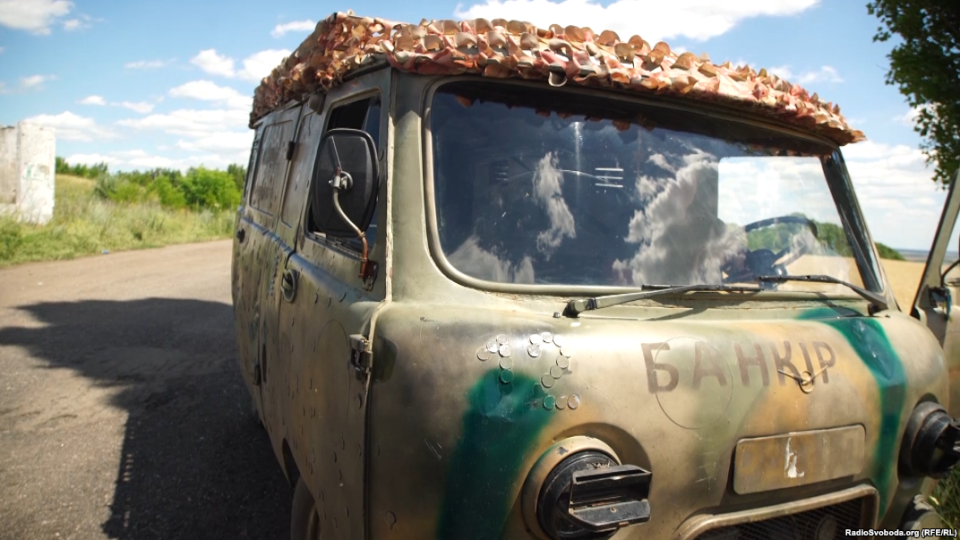 """The UAZ-452 Bukhanka – the """"Bread-Loaf"""" – patched up for service with the Kyiv Battalion. If you look closely, you can see coins in the shape of a """"12"""" over the left headlight."""