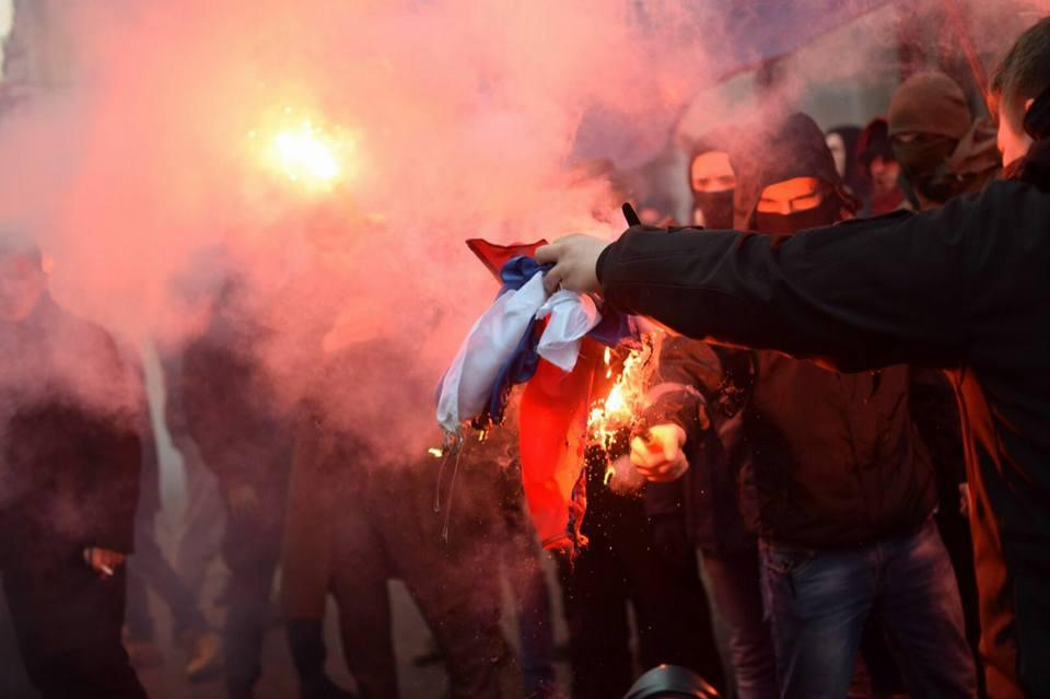 "Right sector activists and other national organizations burn a Russian flag after vandalizing the office of ""Rossotrudnichestvo"" (Russia's agency for the Commonwealth of Independent States, Compatriots Living Abroad and International Humanitarian Cooperation) on 17 February 2018. Photo: pravyysektor.info"