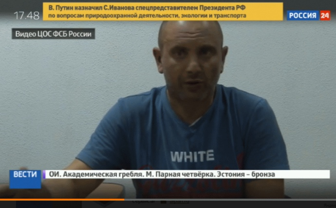"""Andriy Zakhtey's televised """"confession."""" Screenshot from video"""