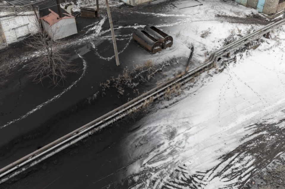 Snow is covered by a layer of soot in a mining station in Donbas