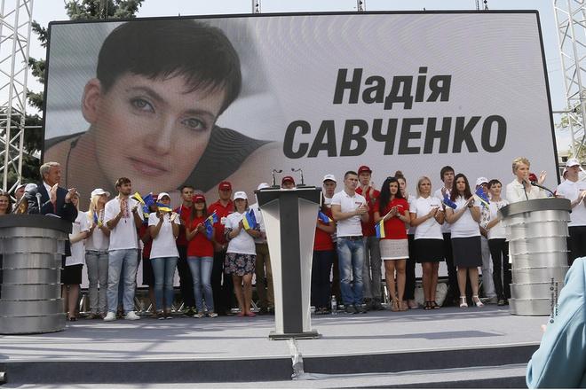 Nadiya Savchenko became part of Batkivshchyna's electoral campaign. Here, party leader Yuliya Tymoshenko is seen speaking in front of a billboard showing Nadiy Savchenko