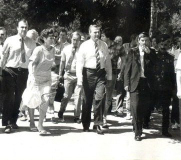 """Before entering into the big politics after his """"retirement"""" from the KGB/FSB, Vladimir Putin (in the background, with a suitcase) was a foreign affairs advisor and then economics deputy for St.Petersburg's Mayor Anatoliy Sobchak from 1991 to 1996. A part of his job responsibilities was to carry his boss's luggage. He became Russia's Acting President on 31 December 1999."""