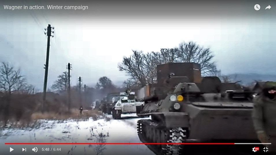 Two MT-LBs, dark green and white painted (which emerged earlier in the clip #5), and 4 Ural trucks behind them (5m48s)