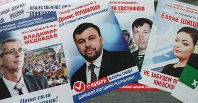 Campaign posters by Pushilin and his rivals look like created by the same designer.