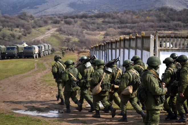 """Russian soldiers without identifying military insignia (the so-called """"green men"""") seizing Crimea. Source: Wikipedia"""