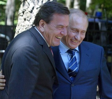 "Vladimir Putin with Gerhard Schröder, former Chancellor of Germany (1988-2005) who became top GAZPROM representative and lobbyist of Putin's interests in the country after leaving his government position. The term ""shroederization"" now stands for the corruption of Western elites by the Putin regime."