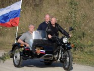 Vladimir Putin riding a three-wheel motorcycle in annexed Crimea with the head of the Russian occupation administration of Crimea Sergey Aksyonov and the acting mayor of Sevastopol Mikhail Razvozhayev (L-R) on August 10, 2019. Photo: kremlin.ru