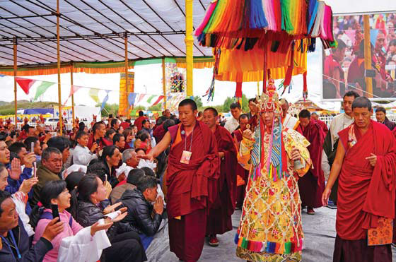 The 11th Panchen Lama Surrounded By Monks Gives Blessings