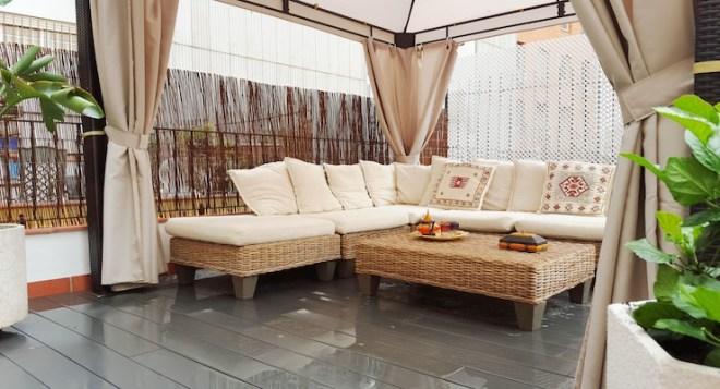 Big luminous terrace with white sofa