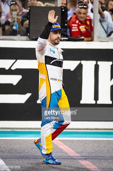 ABU DHABI, UNITED ARAB EMIRATES - NOVEMBER 25: Fernando Alonso of Spain and McLaren F1 waves to the crowd from the track at the end of the Abu Dhabi Formula One Grand Prix at Yas Marina Circuit on November 25, 2018 in Abu Dhabi, United Arab Emirates. (Photo by Lars Baron/Getty Images)