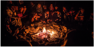 Scouts from several nations around a campfire -- photo from the website of the World Scout Organization.