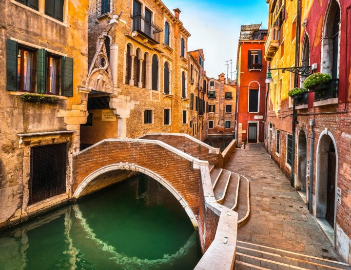 Venice cityscape, water canal, bridge and traditional buildings. Italy, Europe.