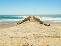 One of pretty piers along Costa da Caparica beaches in Portugal