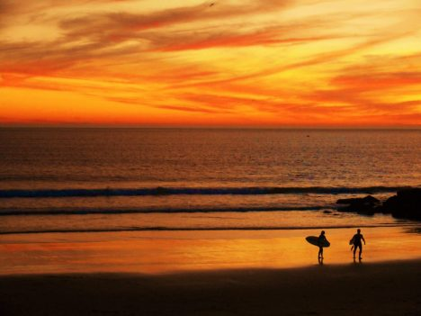Surfing at sunset in Caparica Portugal