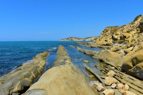 Unusual stripes of limestone in a beach in Narta Lagoon