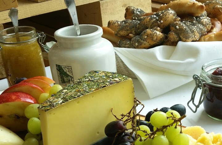 Fresh bread rolls, marmalades and cheeses - Austrian breakfast in a guesthouse