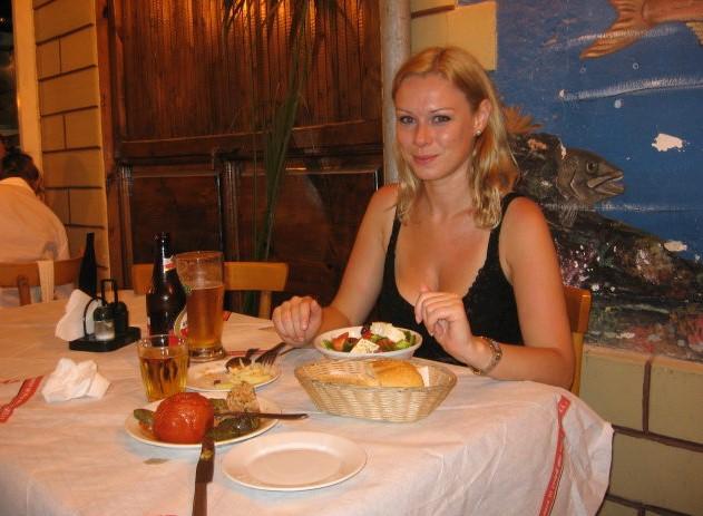 Enjoying delicious Greek cuisine!