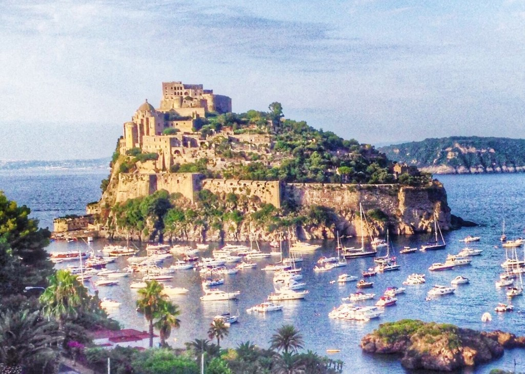 The medieval Aragonese castle emerging from the rock in Ischia, nearby Naples