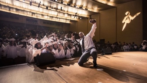 Comedian Dave Chappelle takes a selfie with the Duke Ellington School for the Arts seniors at their graduation at the George Washington University Lisner Auditorium on June 14.